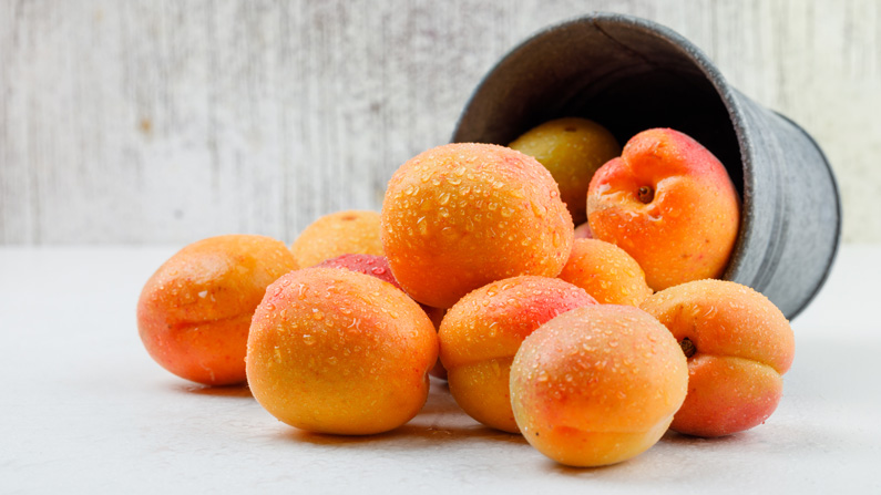 apricots in a mini bucket side view