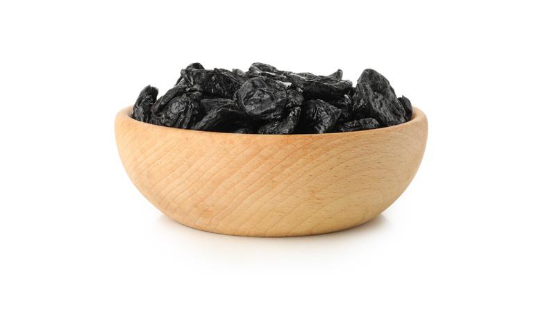 prunes in a brown bowl